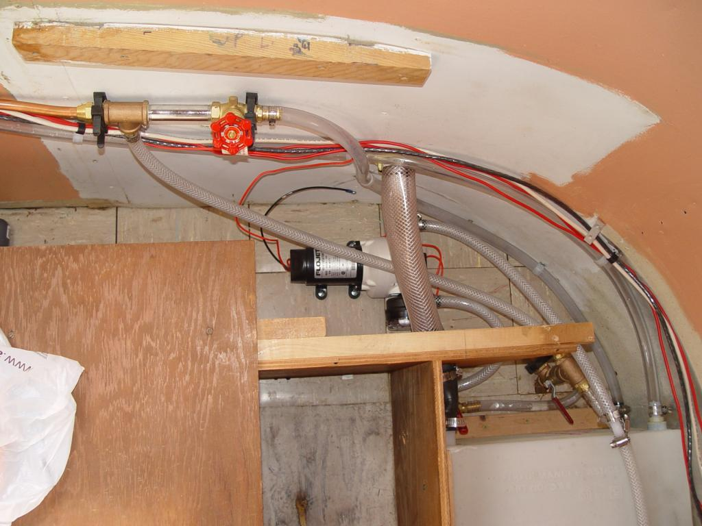 The Interior Solution, new tank, pump and spaghetti of hoses.