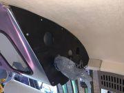 Overhead Bin End Cap Showing Plastic Bag Storage