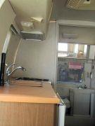 Orange kitchen w/ delaminating counter top