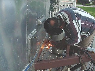 Click image for larger version  Name:Welding the Battery Supports.JPG Views:418 Size:41.5 KB ID:10673