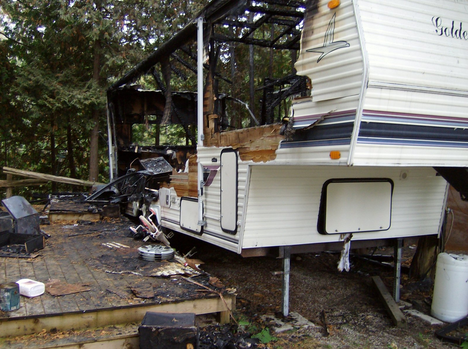 Click image for larger version  Name:Fire Damaged Trailer 001.jpg Views:107 Size:390.8 KB ID:112186