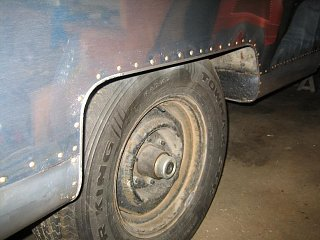 Click image for larger version  Name:Streetside Wheel Well Trim Bucked in Place.JPG Views:88 Size:67.9 KB ID:116327