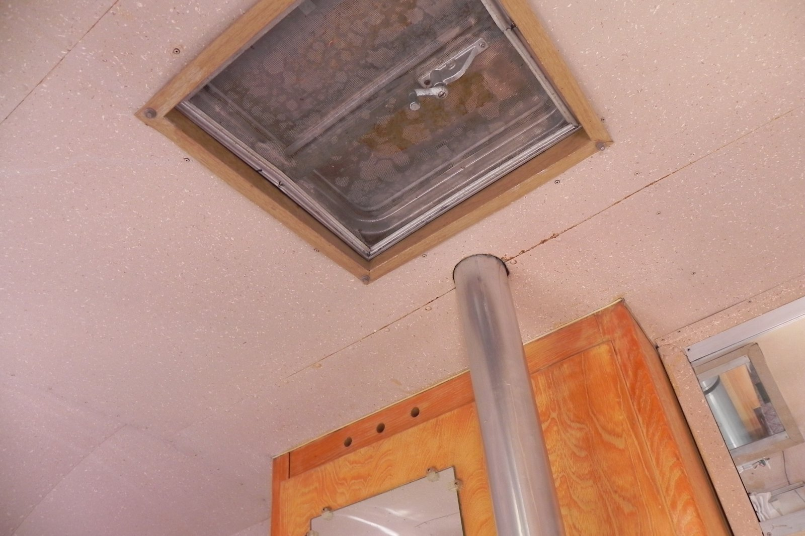 Click image for larger version  Name:ceiling vent and furnace chimney.jpg Views:147 Size:251.9 KB ID:172960