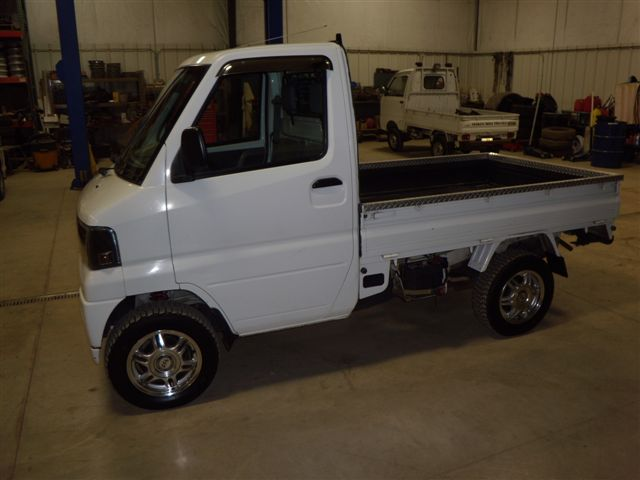 Click image for larger version  Name:2002_Mitsubishi_Mini_Cab_005.jpg Views:51 Size:39.3 KB ID:189850