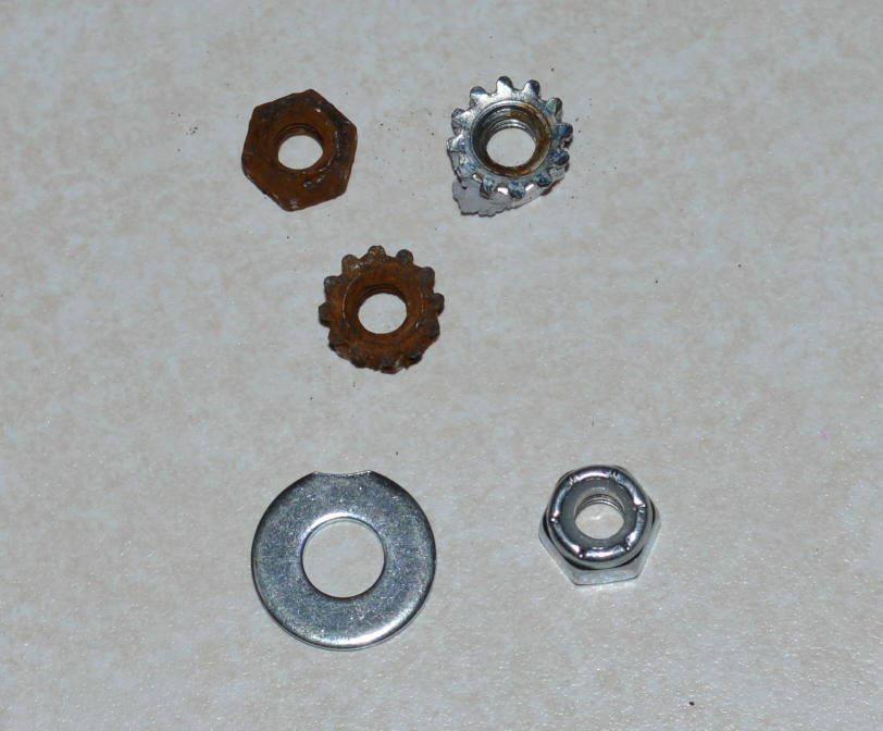 Click image for larger version  Name:replacement washer and nylock nut.JPG Views:65 Size:124.0 KB ID:208293