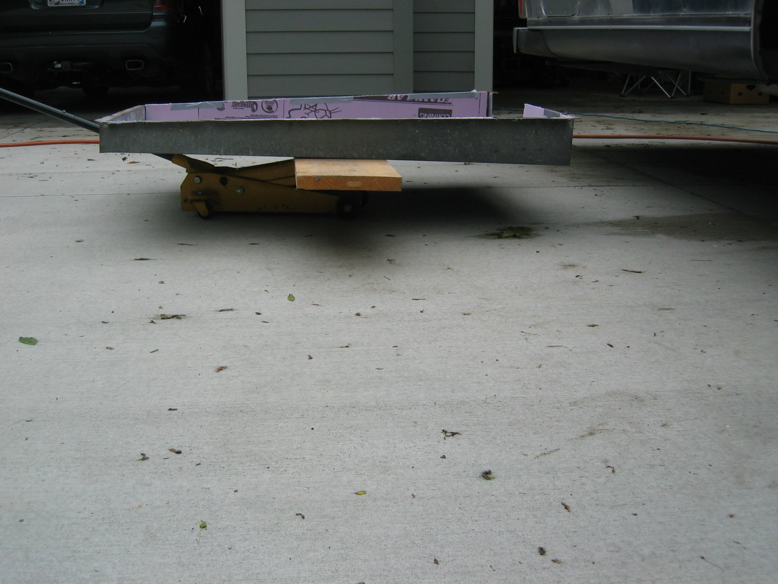 Click image for larger version  Name:1205 Tank Pan on 2x12 on Floor Jack.jpg Views:125 Size:259.5 KB ID:236046