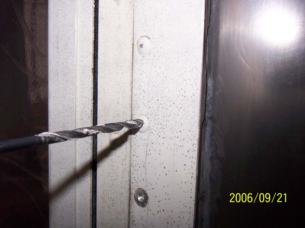 Click image for larger version  Name:Day Eight Drilling Out the Factory Rivets (reduced).jpg Views:73 Size:85.5 KB ID:26175