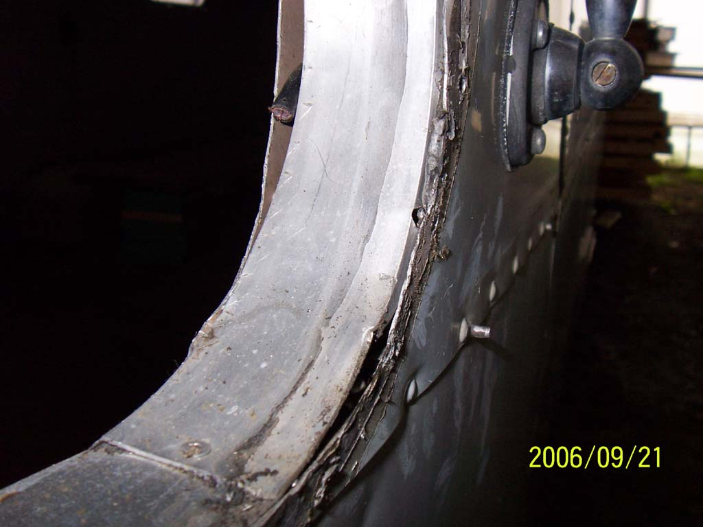 Click image for larger version  Name:Day Eight Damage Under the Streetside Curved Window (reduced).jpg Views:76 Size:81.9 KB ID:26185