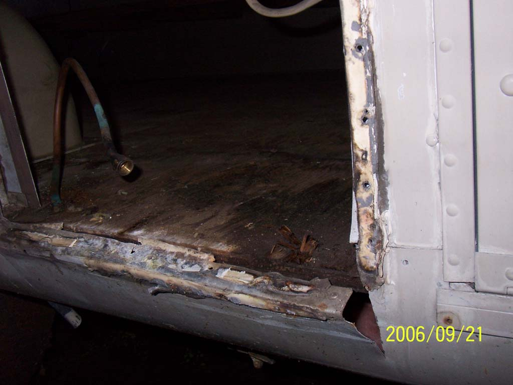Click image for larger version  Name:Day Eight Hot Water Tank Hole Damage (reduced).jpg Views:75 Size:80.5 KB ID:26188