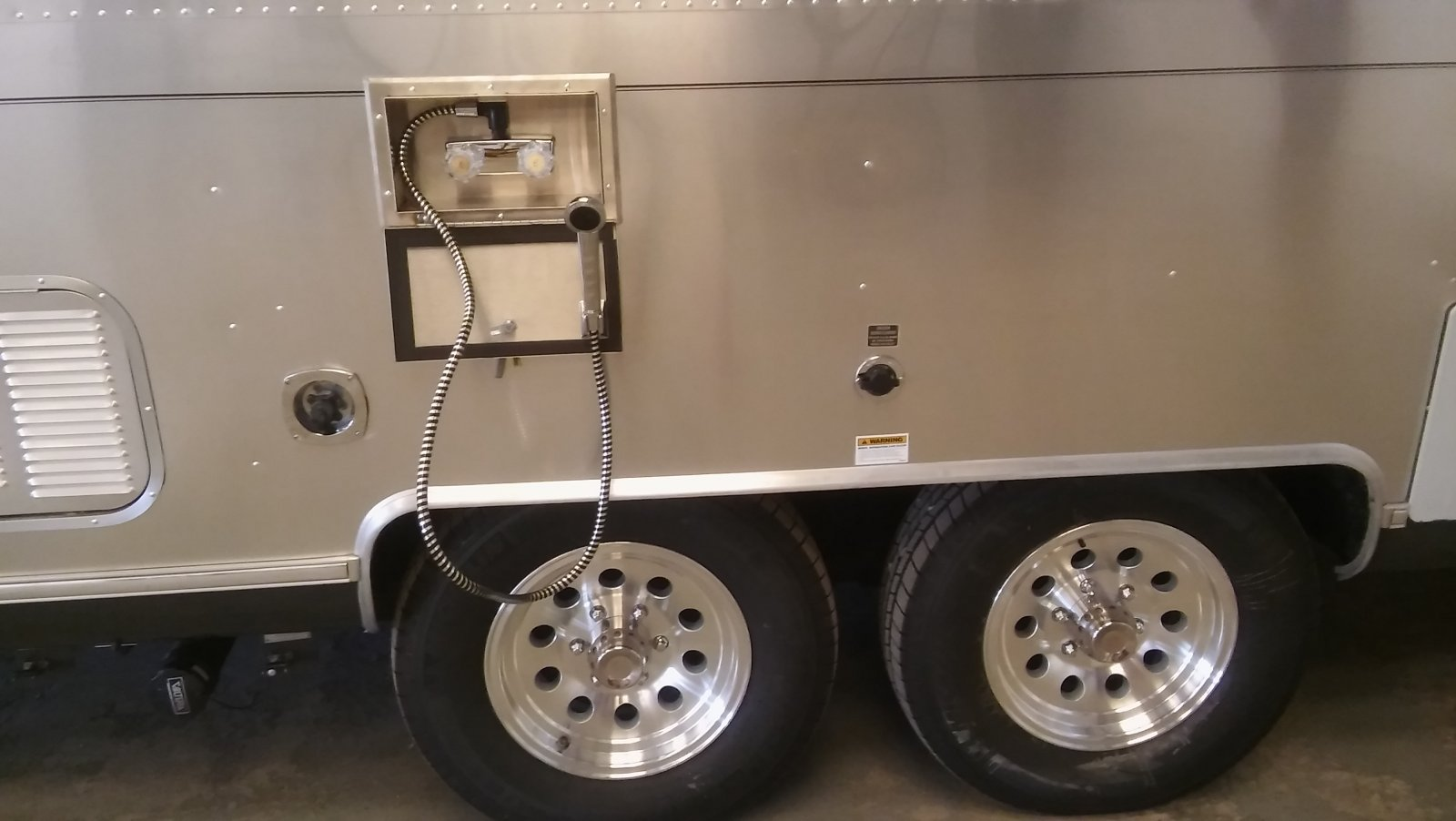 Click image for larger version  Name:Airstream outdoor shower new tires and wheels.jpg Views:369 Size:131.2 KB ID:264201