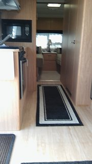Click image for larger version  Name:Airstream with carpet runner.jpg Views:97 Size:123.3 KB ID:264390
