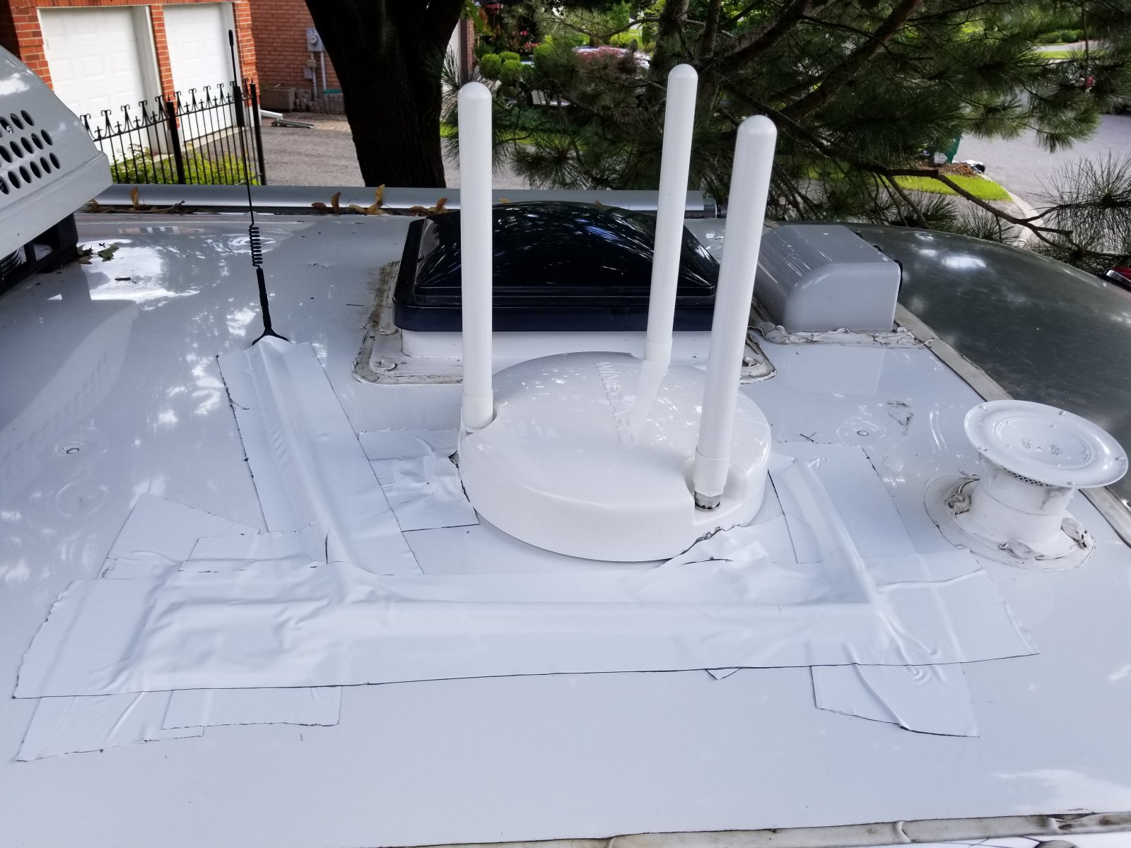 Click image for larger version  Name:Wifi and cell ant mointed with extra wide roof tape2.jpg Views:56 Size:255.6 KB ID:289394