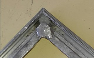 Click image for larger version  Name:Welding and Caulking on Back.jpg Views:91 Size:154.8 KB ID:296868