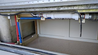 Click image for larger version  Name:Bath Cabinet Bolted Down and PEX and Drain Lines Hooked Up.jpg Views:58 Size:443.0 KB ID:312258