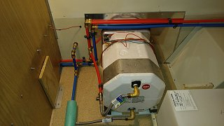 Click image for larger version  Name:New Water Heater Close Out Panel and PEX Lines Secured.jpg Views:48 Size:447.8 KB ID:313682