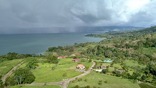 Click image for larger version  Name:Drone wide shot with rain across lake.jpg Views:22 Size:323.2 KB ID:358380