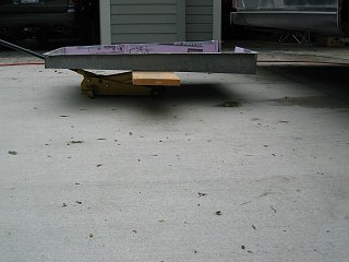 Click image for larger version  Name:1205 Tank Pan on 2x12 on Floor Jack (Small).JPG Views:7 Size:66.6 KB ID:387040