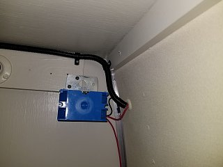 Click image for larger version  Name:Fridge Top 12V Power Outlet Wiring Covered.jpg Views:16 Size:245.3 KB ID:390368