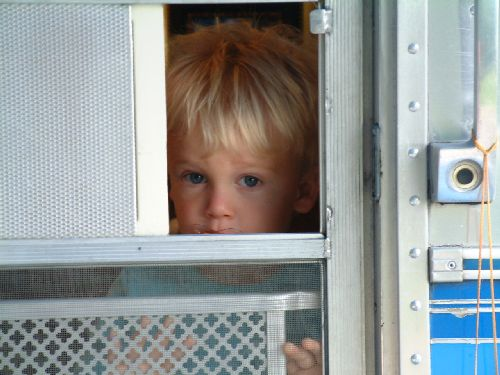 Click image for larger version  Name:justin looking out trailer door.jpg Views:76 Size:37.3 KB ID:46838