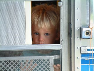 Click image for larger version  Name:justin looking out trailer door.jpg Views:99 Size:37.3 KB ID:46838