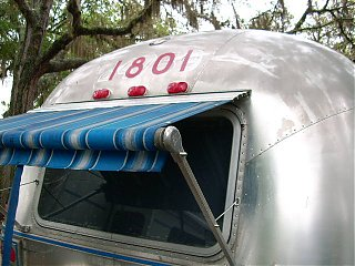 Click image for larger version  Name:rear window awning 002.JPG Views:74 Size:66.2 KB ID:57695