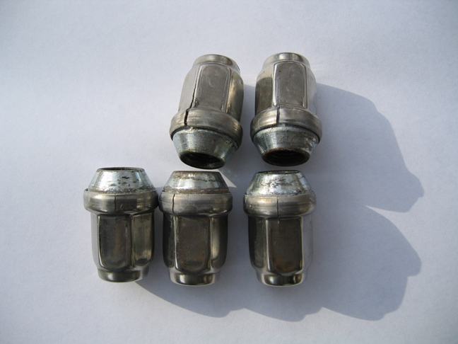 Click image for larger version  Name:Airstream Lug Nut Covers.jpg Views:161 Size:110.4 KB ID:79819