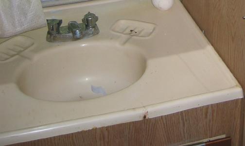 Click image for larger version  Name:damaged_bathroom_sink.jpg Views:168 Size:44.5 KB ID:8138
