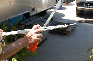 Click image for larger version  Name:DSC_0044 Lubricating awning.jpg Views:107 Size:284.6 KB ID:84496